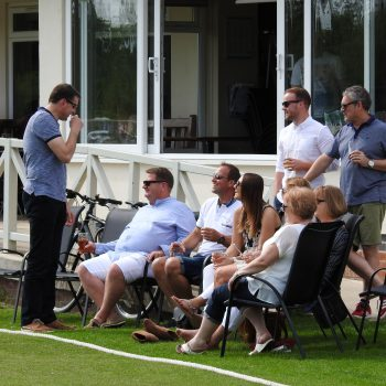 Attenborough Cricket Club people talking by pitch side